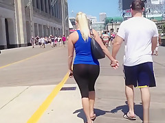 gorgeous blonde girl walking the streets in see through yoga pants