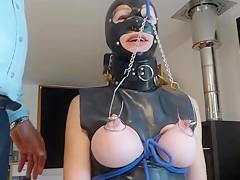 Slave has hooks in tits