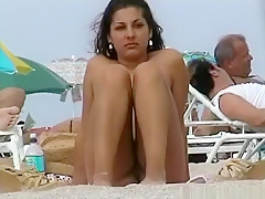 A voyeur capturing pussies and tits of girls on a nude beach
