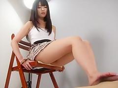 Japanese cute girl doing a footjob